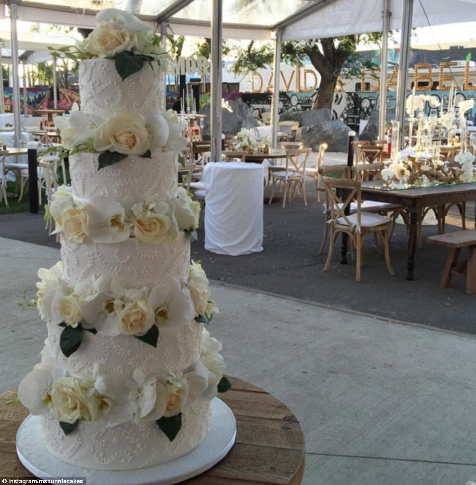 Their 500 guests tucked into a five tier gluten free, vegan cake decorated with fresh flowers