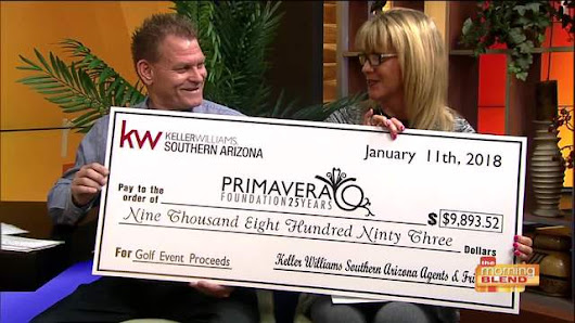 Big check reveal from Keller Williams to Primavera Foundation