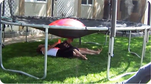 Dad Drenches Kids by Filling Up and Exploding a Giant Water Balloon on Top of a Trampoline