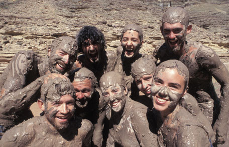 Photo of people in mud