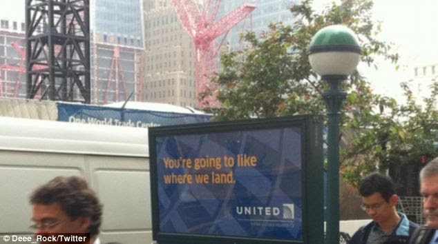 Poor placement: The United Airlines advert, with the Ground Zero constriction site clearly visible just across the road, has been branded insensitive by New Yorkers