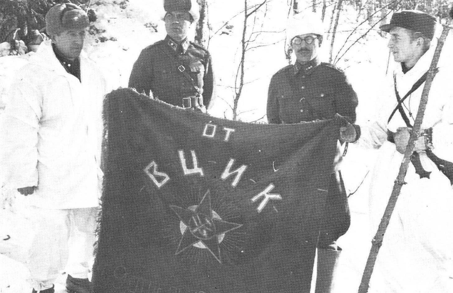Finnish officers posing with a captured Soviet flag, Finland, 1939-1940