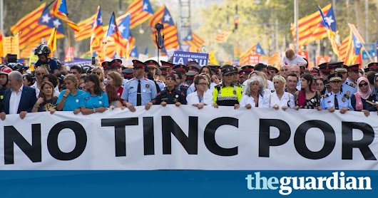 Spain attacks: thousands march through Barcelona in show of defiance | World news | The Guardian