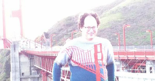 This guy makes sweaters of places and then takes pictures of himself wearing the sweaters at those places.