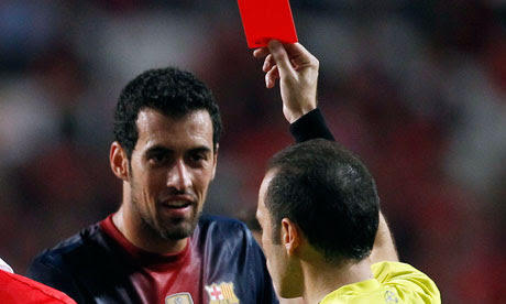 Barcelona's Sergio Busquets is sent off during their Champions League Group G game against Benfica