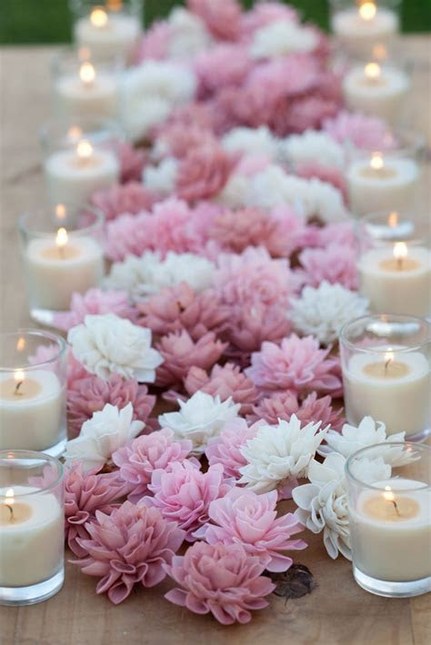 centerpiece of pink & white flowers with candles, very