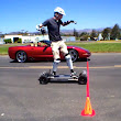 Watch this unlikely drag race between a Corvette and an electric skateboard