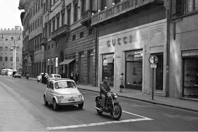 Courtesy of Foto Locchi- A Fiat 500 passes the Gucci store on Via Tornabuoni in Florence, circa1962