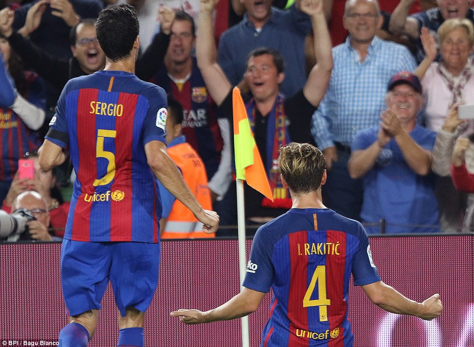 Rakitic slides on his knees in celebration after his header put Luis Enrique's men ahead in the hotly anticipated La Liga clash