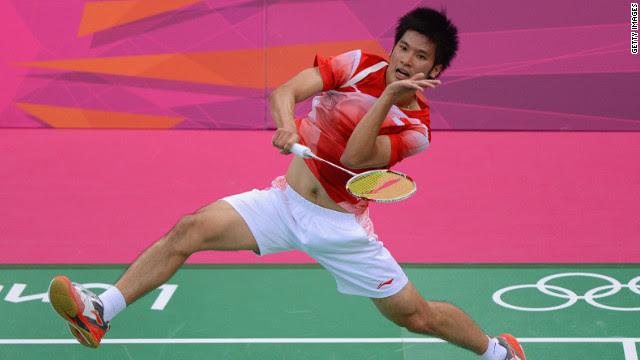 Derek Wong of Singapore returns against Jan O Jorgensen of Denmark during their men's singles badminton match.
