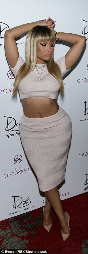Vogue:The beauty struck a series of flirty poses as she displayed her world-famous curves in a very fitted two-piece