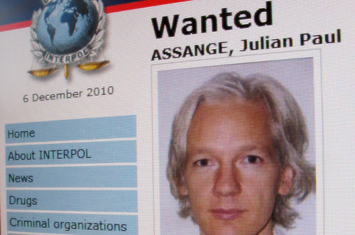 An INTERPOL wanted poster for Julian Assange who was arrested by the British police on December 7, 2010. The WikiLeaks website has exposed U.S. war crimes and other political intrigue carried out by the world's leading imperialist state. by Pan-African News Wire File Photos