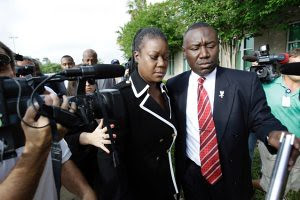 The mother of Trayvon Martin leaves the courtroom with her attorney after the hearing that granted a $150,000 bail to George Zimmerman the suspect in the killing of the 17-year-old unarmed African American youth. People were outraged at the decision. by Pan-African News Wire File Photos