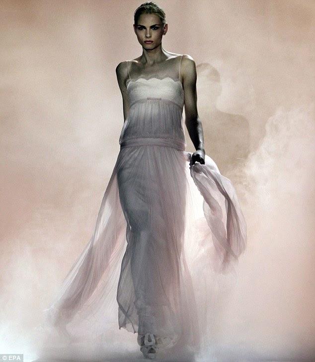 Australian androgynous model Andrej Pejic presents a creation by Spanish designer Rosa Clara