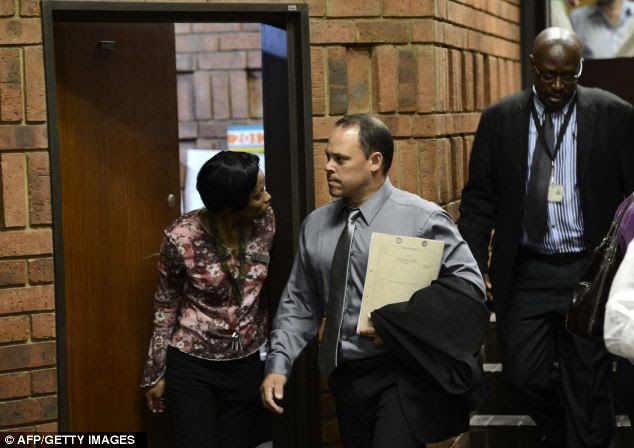 Detective Hilton Botha said he believed the bullets were fired down suggesting Pistorius was wearing his prosthetic legs when the shots were discharged