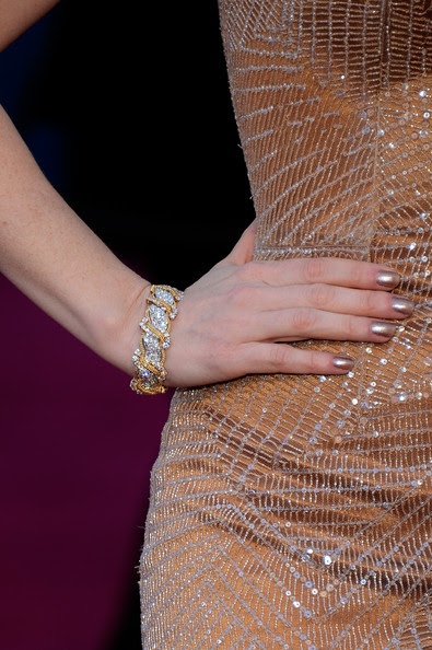Actress Jessica Chastain (jewellery detail) arrives at the Oscars at Hollywood & Highland Center on February 24, 2013 in Hollywood, California.