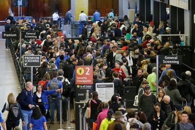 Travelers waited in line for security screening at Seattle-Tacoma International Airport in Seattle in March.