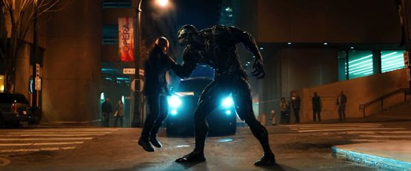 Venom confronts a bad guy in VENOM.