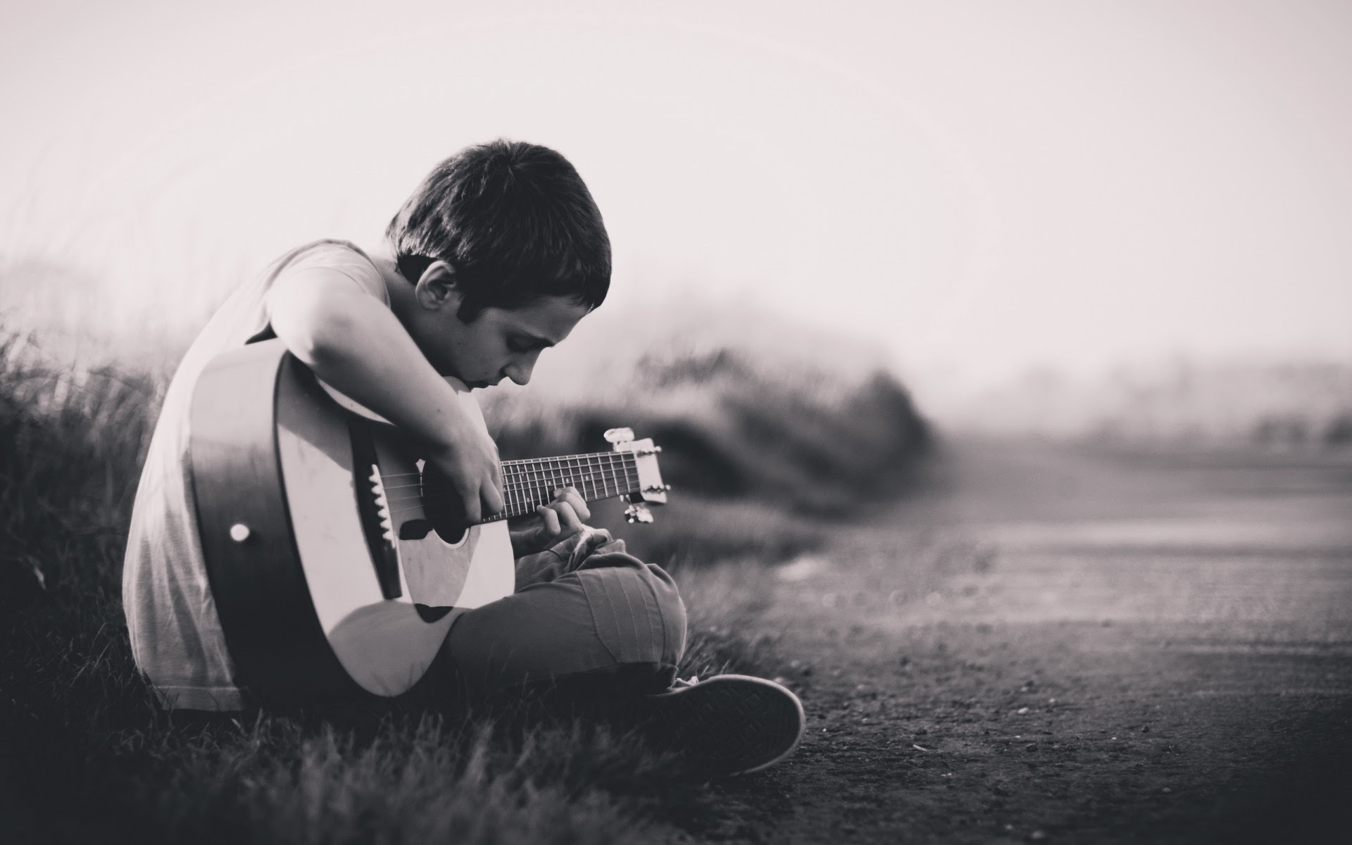 sad alone boy with guitar