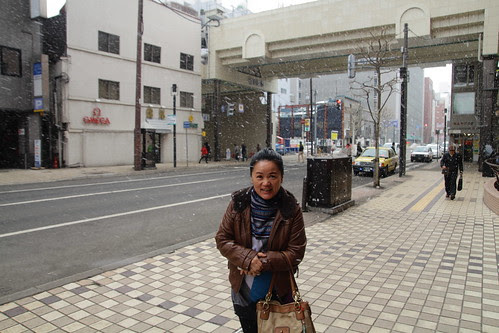Mom standing under the Sapporo snow