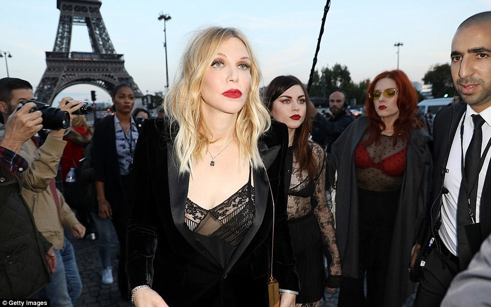 Rock royalty: The blonde beauty was going braless beneath her racy sheer cami with a velvet blazer underneath