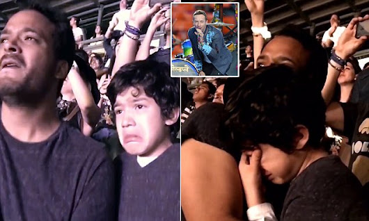 Autistic boy cries with happiness as he watches Coldplay perform live