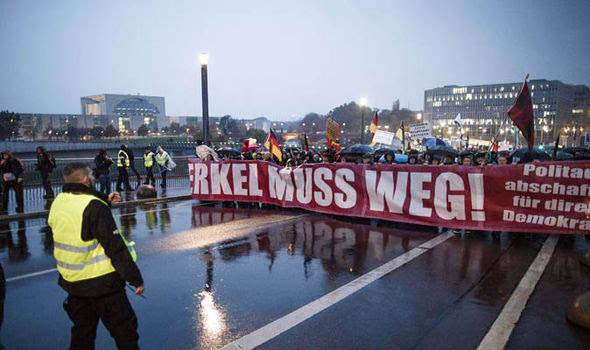 Protesters against Angela Merkel