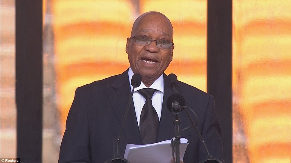Embarrassing: South African Jacob Zuma was roundly booed by the crowd when he got up to deliver his tribute to Mr Mandela