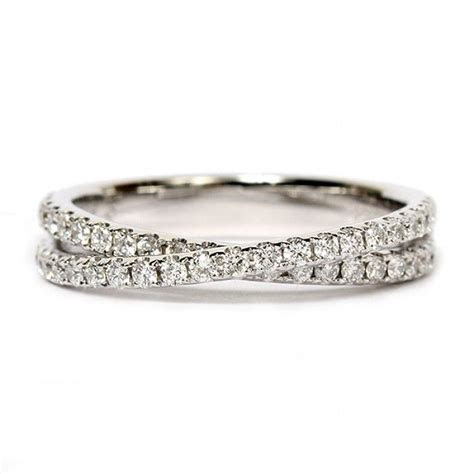 This artfully crafted 14K white gold wedding band by Scott
