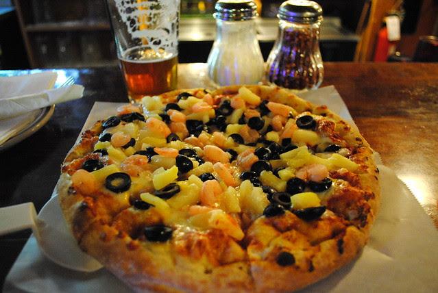 Oregon shrimp, black olive, and pineapple pizza at Zigzag Inn