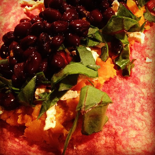 Rolling up sweet potato, Swiss chard & black bean enchiladas #vegan