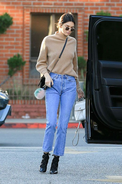 Le Fashion Blog Kendall Jenner Camel Knit Turtleneck High Waisted Jeans Black Boots Via Harpers Bazaar