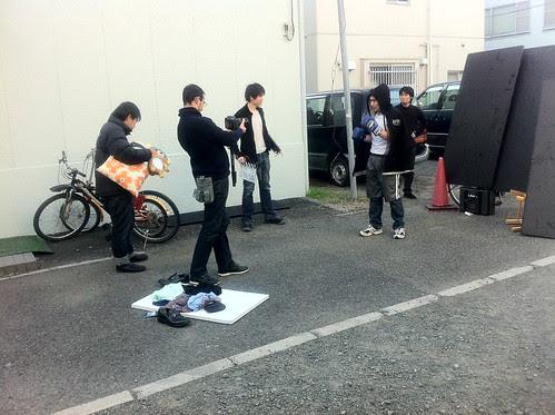 At the film set of men throwing stuff at hobo boxer