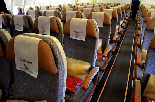 Flying in Coach – A Quick Review of Three Airlines - LandLopers