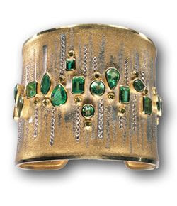 Atelier Zobel yellow gold and platinum cuff with emeralds and diamonds.