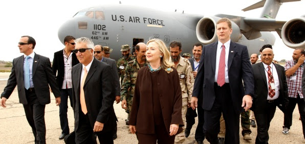 Hillary Clinton walks from  her C-17 military transport upon her arrival in Tripoli  Libya, Oct. 18, 2011.