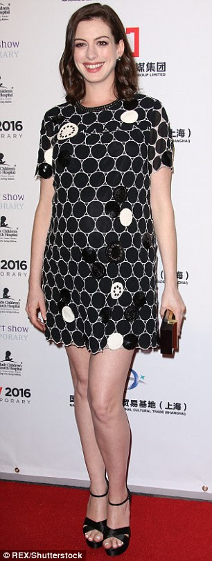 Blooming lovely: Anne wore a printed black and white mini-dress, which displayed her burgeoning belly and her long legs