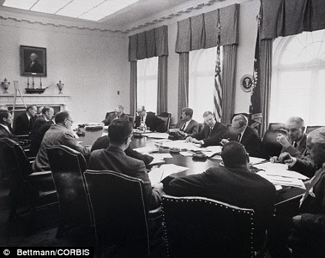 Tense times: President Kennedy meets with advisers in October 1962 as the Cuban Missile Crisis unfolded