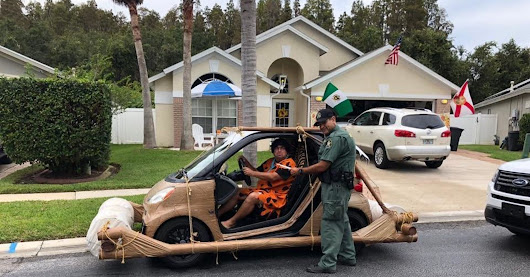 'Fred Flintstone' Arrested In Florida For Speeding In Prehistoric Smart Car | HuffPost