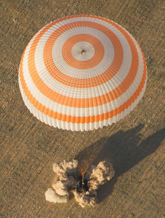 The Soyuz TMA-04M spacecraft is seen as it lands with Expedition 32 Commander Gennady Padalka of Russia, NASA Flight Engineer Joe Acaba and Russian Flight Engineer Sergie Revin in a remote area near the town of Arkalyk, Kazakhstan, on Monday, September 17, 2012. Pic: NASA/Carla Cioffi