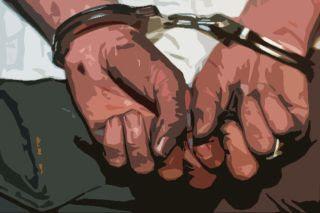 Hands cuffed