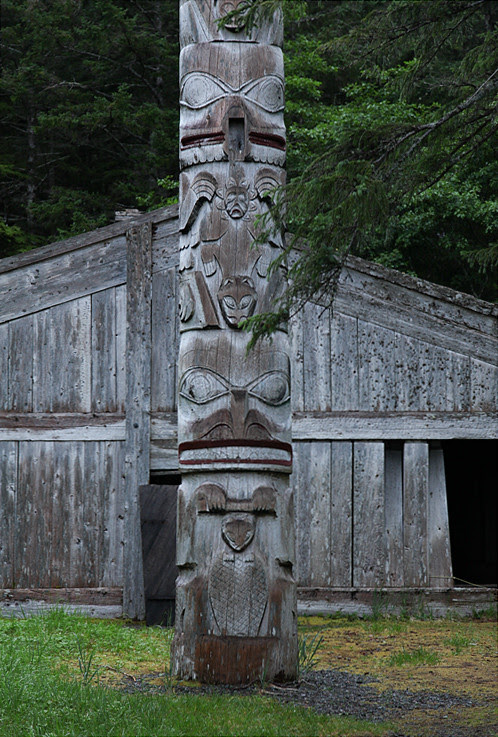 frontal totem pole and Naay I'waans, Chief Son-i-Hat Whale House, Kasaan, Alaska