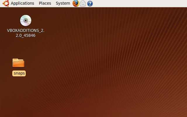 Default orange and brown Ubuntu desktop. First, we'll start by installing