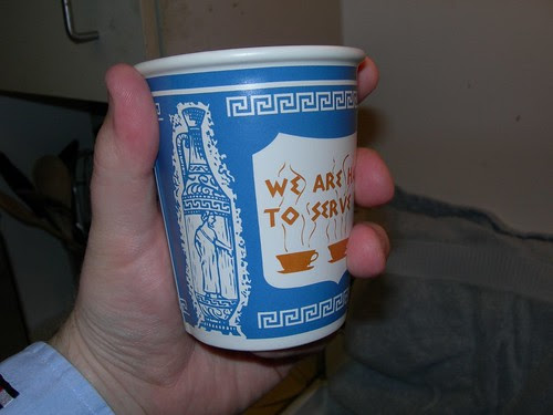 We Are Happy To Serve You Coffe Cup in hand