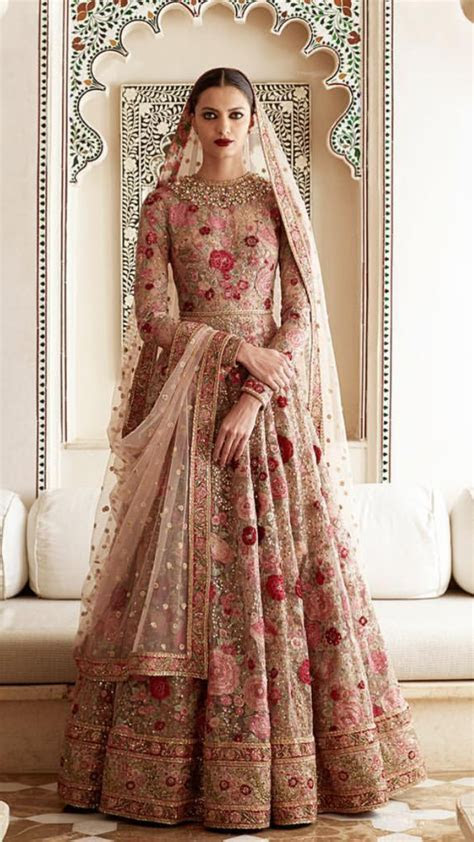 Sabyasachi  for custom bridal and party wears email