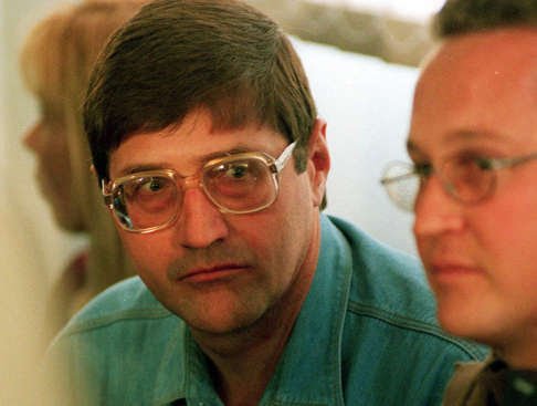 This file photo taken Sept. 14, 1998, shows Eugene de Kock, head of a covert police unit that tortured and killed dozens of people, as he attends an amnesty hearing of the Truth and Reconcilliation Commission (TRC) in Pretoria, South Africa.