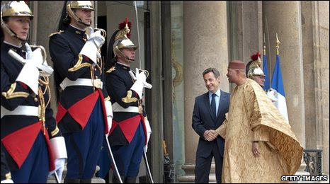 French President Nicolas Sarcozy greets his Malian counterpart Amadou Toumani Toure prior to a meeting at the Elysee Palace in Paris