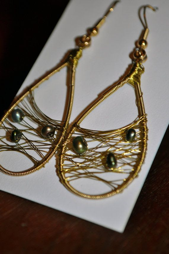 Recycled Guitar String Earrings wired with Freshwater Green Peacock Pearls!
