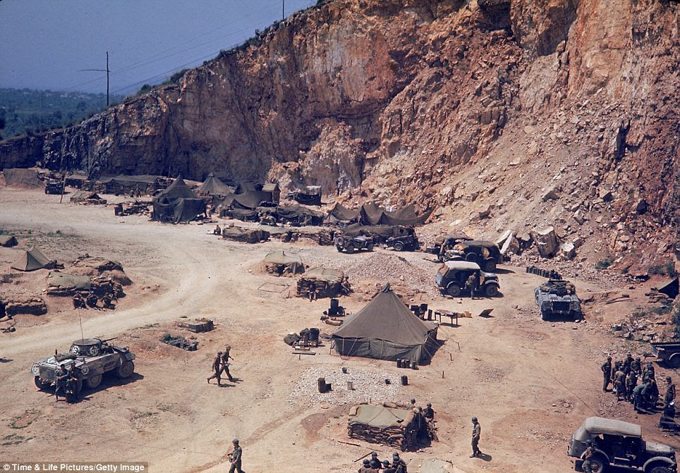 Long slog: American soldiers camp along the roadside as they drive towards Rome. The long and bloody Italian Campaign began with the 1943 invasion of Sicily and the ouster of German troops from the 1,000 square mile Mediterranean island