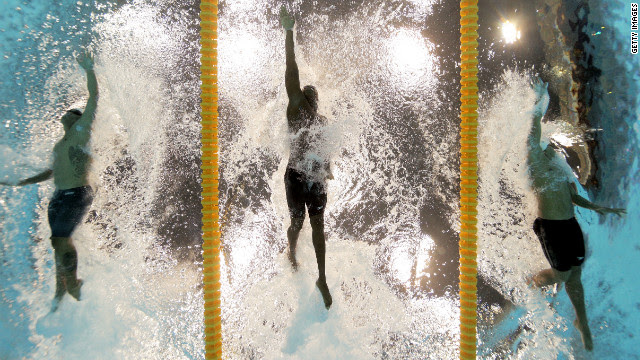 From left, Ahmed Husam of the Maldives, Mamadou Soumare of Mali and Beni Bertrand Binobagira of Burundi compete in the men's 100-meter freestyle heat Tuesday.